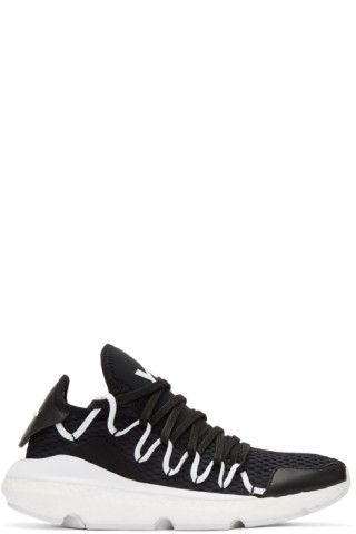 Low-top Primeknit sneakers in 'core' black. Tonal buffed leather and suede  panels throughout. Exposed seam detailing at round toe. Tonal lace-up  closure.