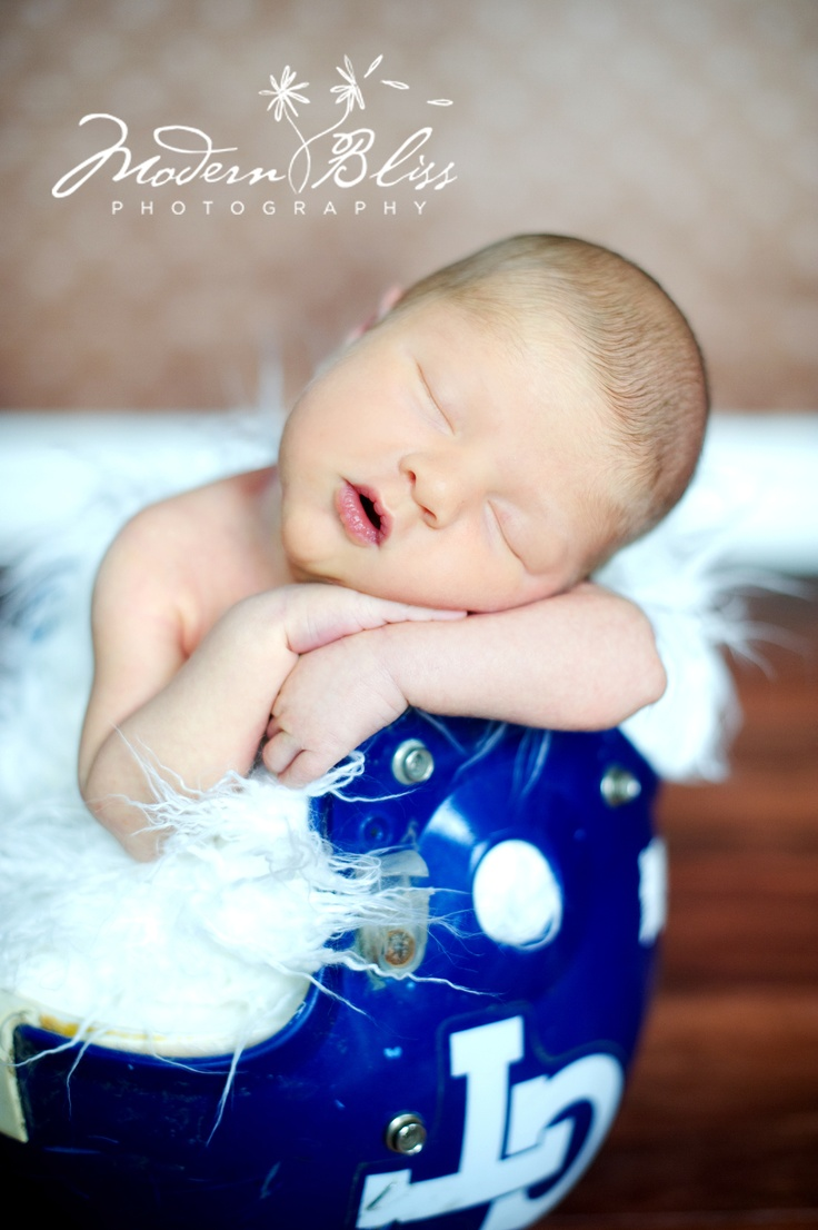 Denise will be doing my maternity and newborn shoot! Here is a sample of her beautiful work! Newborn boy in a football helmet by Modern Bliss Photography!