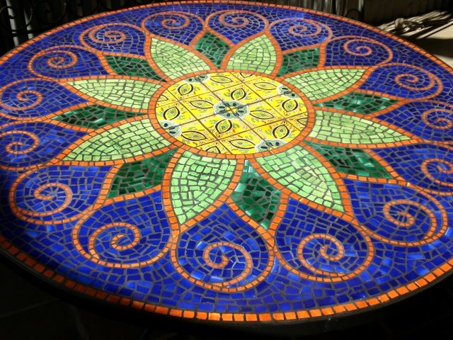 Mine won't be this beautiful but I'm planning to make a mosaic table eventually