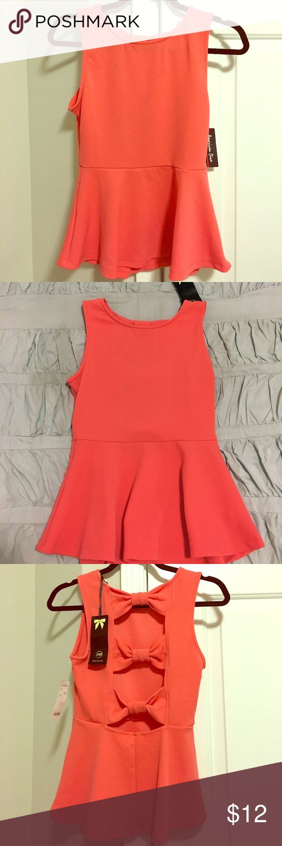🆕 Adorable Coral Orange Shirt 💜 NWT! Adorable Coral Orange Shirt 💜 GREAT CONDITION. This beautiful shirt has a fitted front with and gorgeous open back! Perfect going out shirt that can be dressed up easily! New With Tags! Bundle with another item in my closet and save $$$ ☺ Iris los angeles Tops