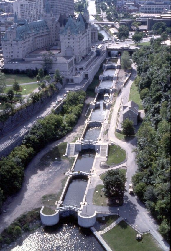 Canal Rideau, through downtown Ottawa, Ontario, Canada - with the Chateau Laurier (above left) and the Col. By series of locks linking to the Rideau river (above) leading to Lake Ontario. --MR