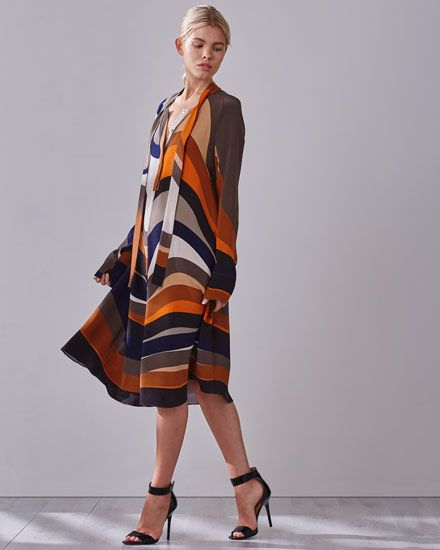 A stand-out design, this swing dress is made from silk crêpe de chine. It features our wavy print – painted by our in-house artist and inspired by Bauhaus architecture. Vivacious colours, including burnt orange and royal navy, sit alongside neutral hues to create a piece that is easy to wear. Further features include an inverted centrefront and back pleat, signature buttons on centrefront placket and split cuffs on outer sleeve. Leave the neck pulls untied for a contemporary look.