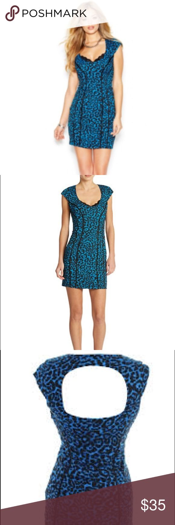 Guess Blue Leopard Print Bodycon Dress  Sexy leopard print dress with cap sleeves is a hot number for going out. Stretchy jersey fabric. Has a cutout in the back and Lace trim above the cleavage  Guess Dresses Mini