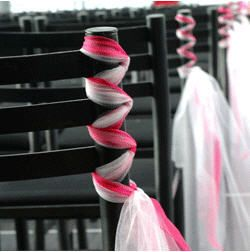 "tulle ""twist"" on chair decor"