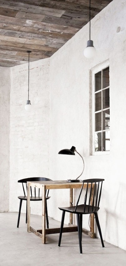 white walls, wood ceiling, pendant light, table, side chairs