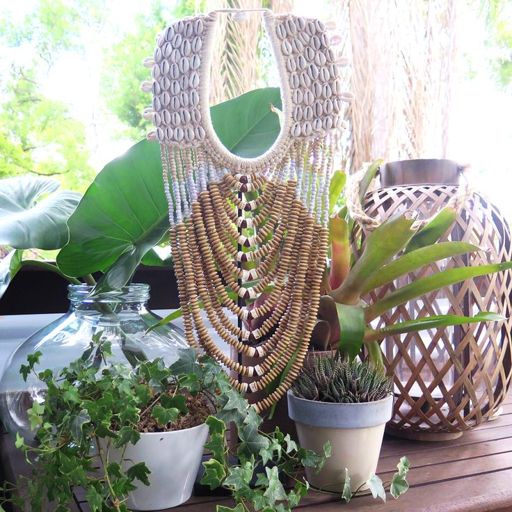 One of our favourite pieces from our Tribal range is this long drop beaded neck-piece. Sold inclusive of metal display stand this piece stands at a very grand 65cm tall. This is intricately made by hand from shells and beads and has a crochet backing.  Dimensions: H65cm x W23cm
