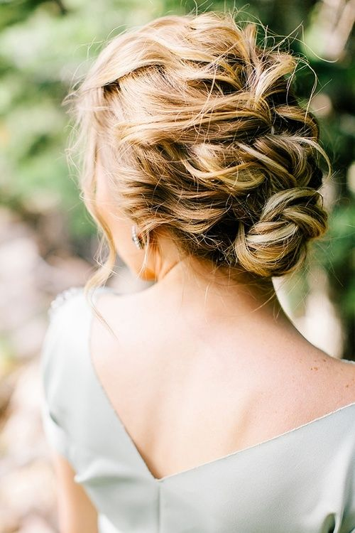 Soft waves with loose braid and a bun at the nape of the neck