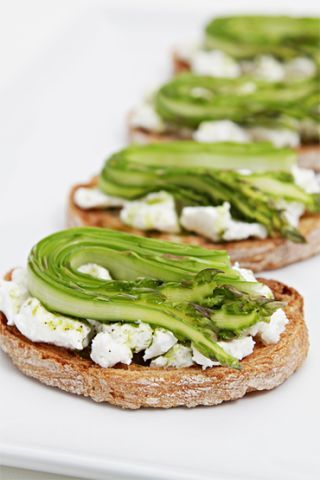 Bruschetta with fresh goat cheese, shaved asparagus and chive-infused oil