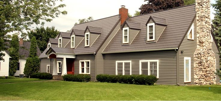 Cape cod style new england cottage home traditional for Cape cod siding ideas
