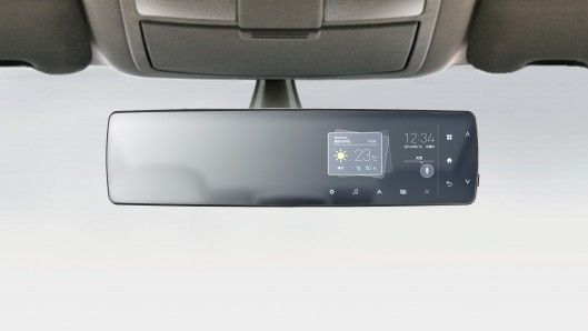 Japan's Pioneer Corporation has developed one way to keep up with the motoring digital Joneses in the form of its rearview mirror telematics unit – a wireless information module that fits over a car's original rearview mirror.