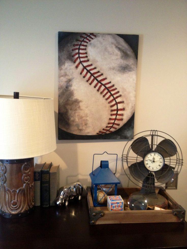 Dresser close up! Husbands childhood baseballs, vintage books and toys.. Fun!