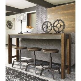 Make your home the hub for cool vibes with the torjin long counter table set. Two-tone finish scheme of distressed warm brown and aged gunmetal is full of urban industrial swagger. Long length makes it suitable for 3 people to sit. Add it behind your sofa with the torjin stools for a dapper eating or working space.