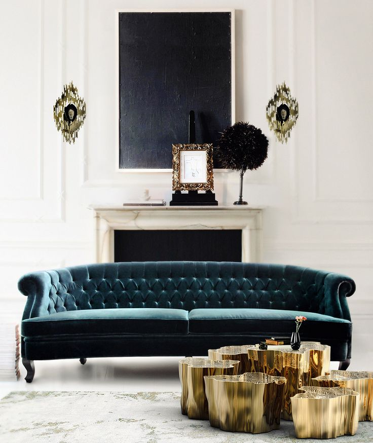 Dark blue, tufted and velvet sofa in white living room