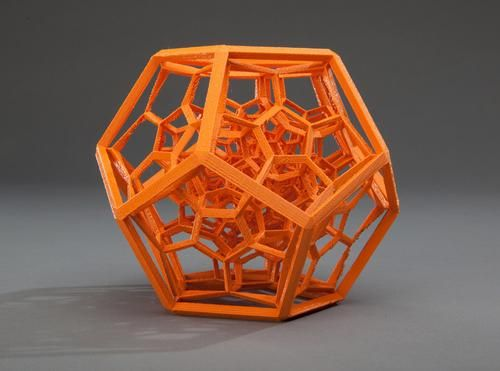 3D printed pentagons in a 3D printed icosahedron. Good luck to any person who attempts to do this by hand.