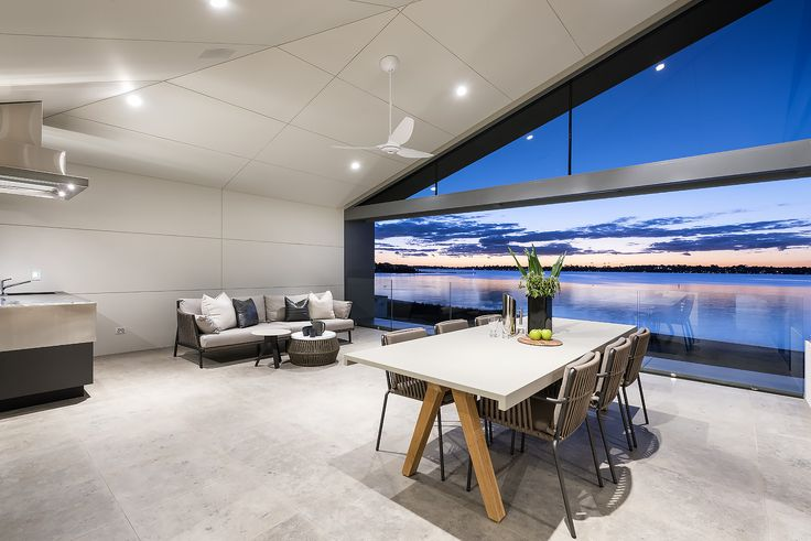 Alfresco dining overlooking Perths spectacular Swan River. Architect: Greg Davies Architects. Builder: Urbane Projects