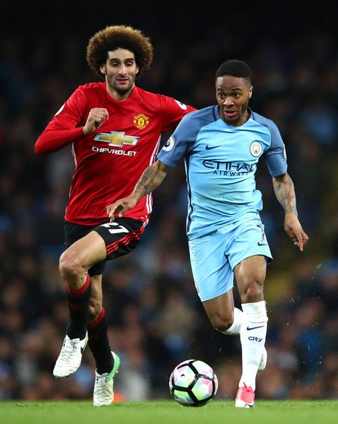 Raheem Sterling of Manchester City is chased down by Marouane Fellaini of Manchester United during the Premier League match between Manchester City and Manchester United at Etihad Stadium on April 27, 2017 in Manchester, England.