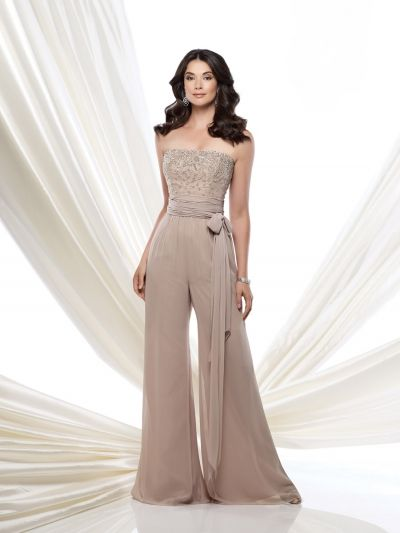 Size 12 Oyster Montage by Mon Cheri 115976 Formal Jumpsuit- Montage by Mon Cheri offers this lovely jumpsuit for those who prefer to wear pants at the wedding or other social occasion. This strapless chiffon high waist jumpsuit comes with the removable straps as well as a matching shawl. The bodice features a shimmering design encrusted with hand beading, a ruched wrap tie belt at the midriff, and wide flowing pant legs.