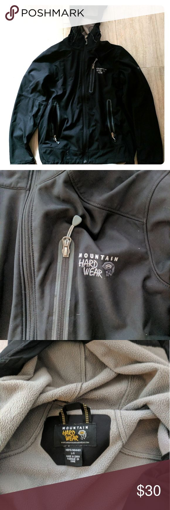 Warm men's outdoor jacket This light windbreaker is lined with fleece for ultra comfort and cozy factor. Good condition. Hood and multiple adjustable cords Mountain Hard Wear Jackets & Coats