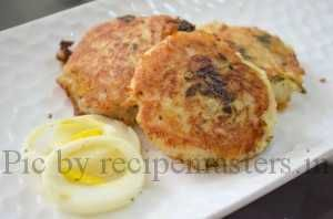 Anda+Aloo+tikki,+a+yummy+fried+snack..very+easy+to+make..+its+just+thin+slices+of+boiled+egg+stuffed+in+aloo+tikkis+and+fried+till+crisp.+Enjoy+this+tasty+snack+with+tomato+ketchup+and+green+chutney.