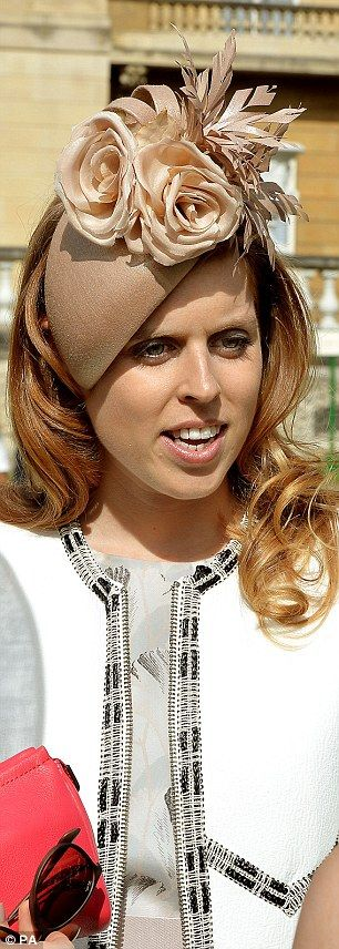 Princess Beatrice talks to guests during a garden party held at Buckingham Palace, central London 28 May 2015