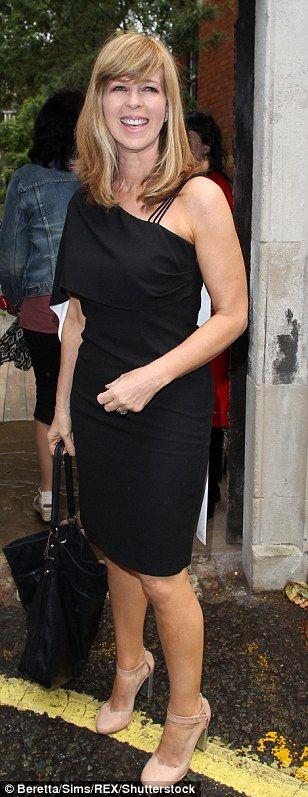Keeping it simple: TV presenter Kate Garraway wore a black asymmetrical dress and nude heels