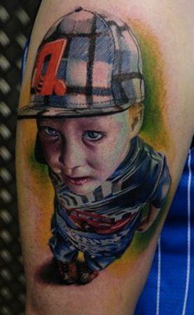 little boy by Florian Karg   tattoo artist – Bayern, Germany