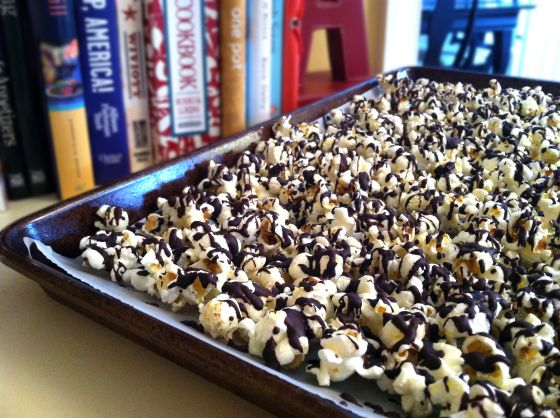 Dark Chocolate Drizzled Popcorn... a seriously delicious, totally addictive and super easy to make treat and the perfect reward for surviving yet another snow day. http://beetsandbluecheese.com/2014/02/13/snow-day-chocolate-popcorn/