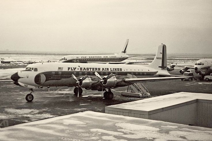 Eastern Airlines DC-6B with an Eastern Airlines DC-8 in the background
