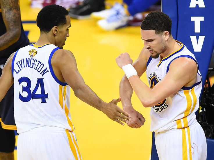 Golden State Warriors guard Shaun Livingston (34) and guard Klay Thompson (11) celebrate a scoring play against Cleveland Cavaliers during the second half in Game 2 of the NBA Finals. Bob Donnan-USA TODAY Sports