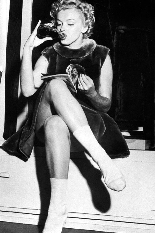 Marilyn Monroe drinking a Coca-Cola, 1951