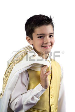 Un ni o en su primera comuni n celebraci n de su chaqueta Foto de archivo