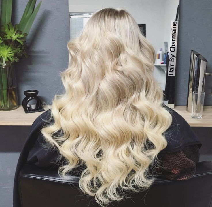 Blonde thick wavey curly hair tape extentions long hair. Hair by Charmaine