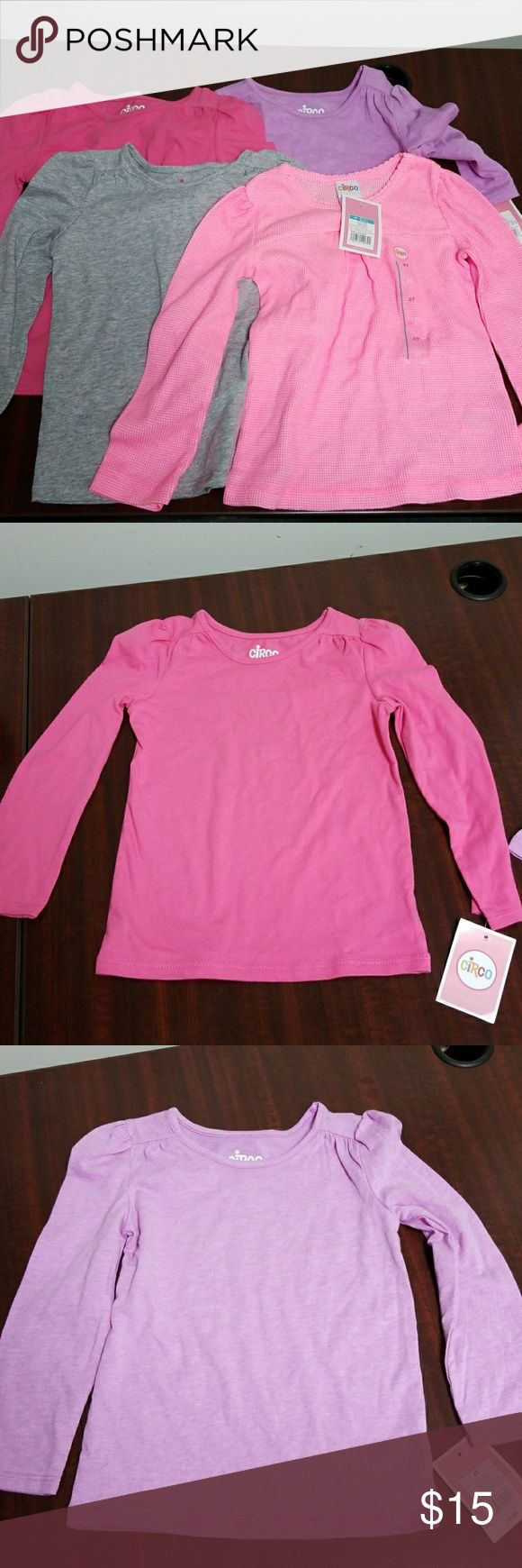 NWT Circo Girls long sleeve t-shirts 4T NWT Circo Girls long sleeve t-shirts 4T. Three are regular and one is a thermal. This listing is for all 4 shirts. Two pink, one gray and one lavender. Circo Shirts & Tops Tees - Long Sleeve