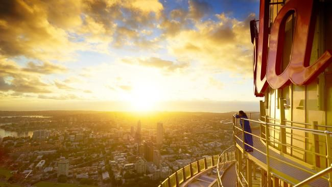 Summer Solstice Around the World - A visitor scans the skyline and harbor of Sydney from a viewing platform at the Sydney Tower Eye in Sydney, Australia.