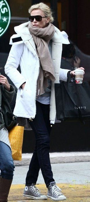 my puffy white winter parka never looks this fashionable on. will pair with sunnies, an oversized scarf, and converse next time. | See more about Charlize Theron, Winter Parka and Oversized Scarf.