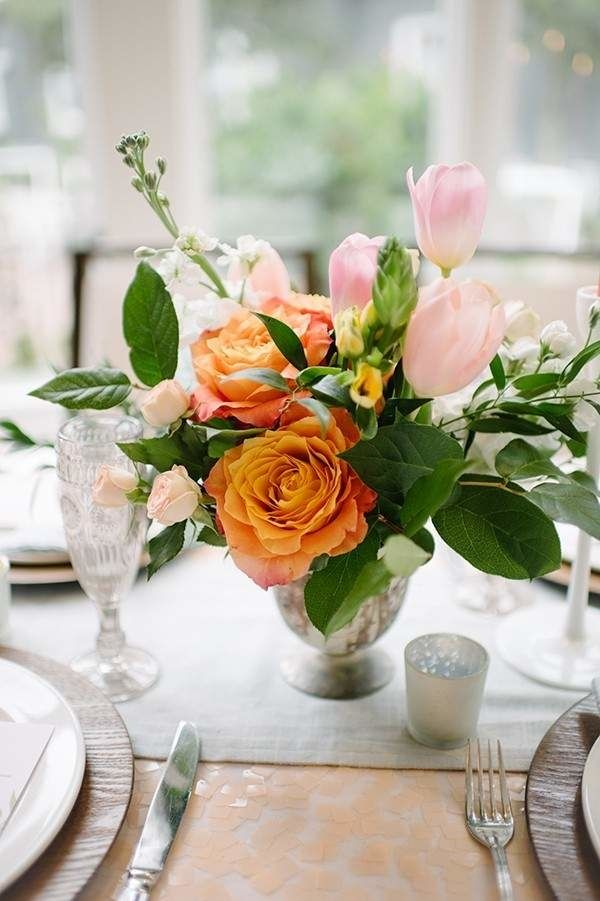 Peach rose and pink tulip wedding arrangements from mywedding magazine.