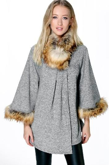 Our new favourite trend which is popular in other parts of the world is the cape which remains a very classy style. You can find some with nice faux fur details, fun aztec patterns or even with fringes. This is a go-to look if you like the hobo chic style.  Faux Fur Collar & Cuff Cape grey - boohoo