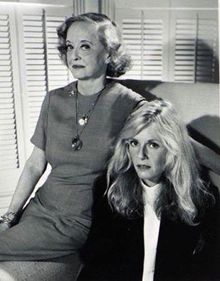 Bette Davis and Kim Carnes, 'She's got Bette Davis Eyes'.