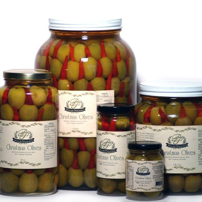 Christmas Olives (Turkish Pepper) - These turkish pepper stuffed olives are hot and addicting!  This spirited treat isn't just for Christmas.  Plump Spanish Queen Olives are hand stuffed with delicious HOT Turkish Peppers and elegantly arranged to resemble a Christmas tree.  Perfect garnish for a Texas Martini.  2 oz - gallon jar