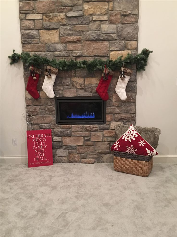 creative way to hang christmas stockings over a modern fireplace without a mantle use avery 5lb. Black Bedroom Furniture Sets. Home Design Ideas