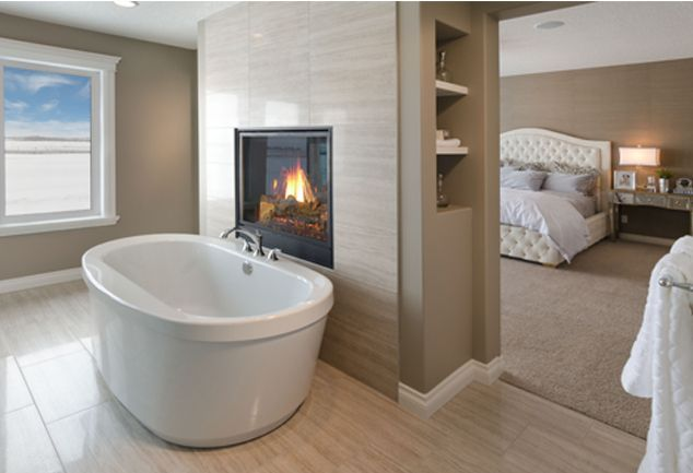 Morrison Homes Savannah Showhome - Winner of a 2013 #SAMCalgary Award, keep warm with this two way fireplace for relaxing winter baths or just laying in bed