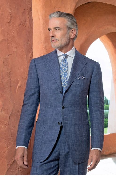 An gray sharkskin suit + paisley necktie and pocket square.