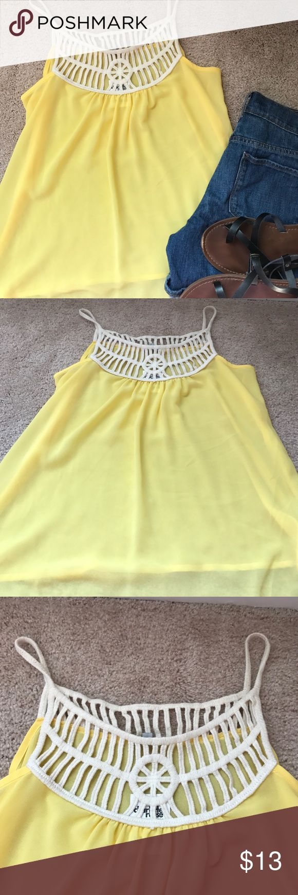 NWT Charlotte Russe Bright Yellow Tank Top Super summery Bright Yellow Tank Top NWT, never worn..Size M..fabric is Sheer and has a cute rope like detail to the top.. measurements laying flat: length 23 inches, bust 17 inches, waist 22 inches Charlotte Russe Tops Tank Tops