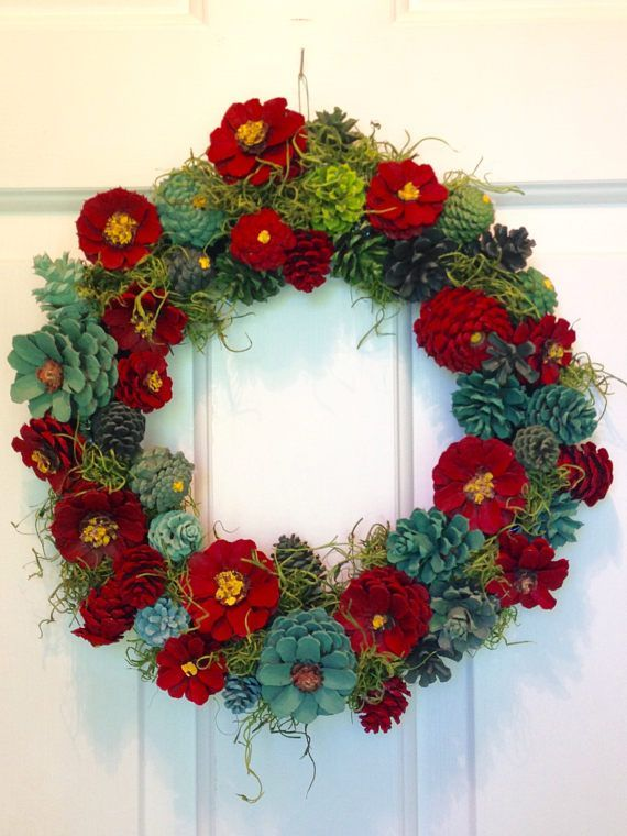 hand painted pinecones in shades of red and green embellished with