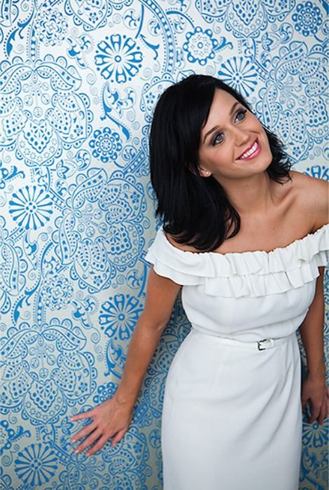 Katy Perry. I love the contrast of the patterned blue background and her simple white dress.