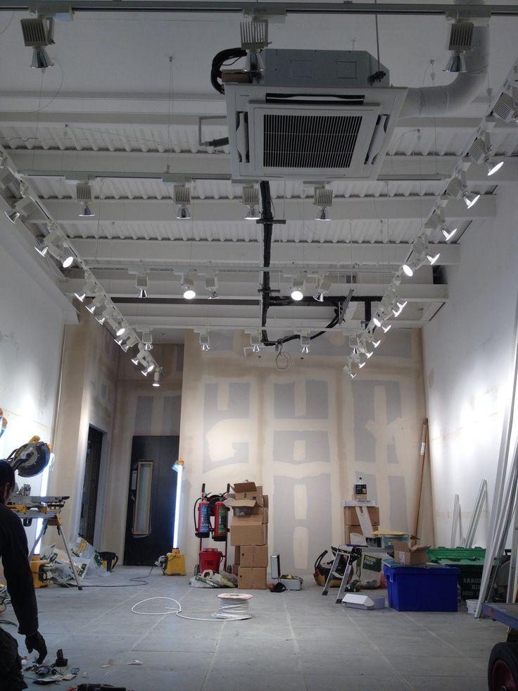 track lighting for high ceilings. track lighting suspended from 4 metre high ceilings for