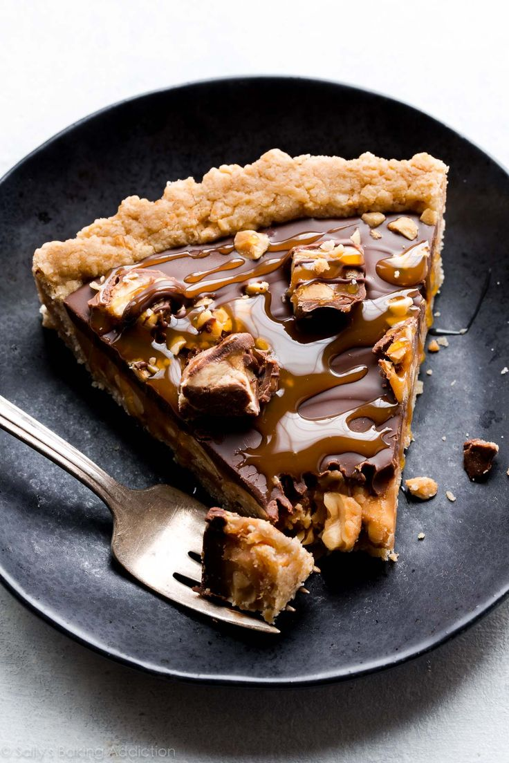This Snickers caramel tart combines caramel, salty peanuts, chocolate, and peanut butter for one irresistible sweet and salty dessert!