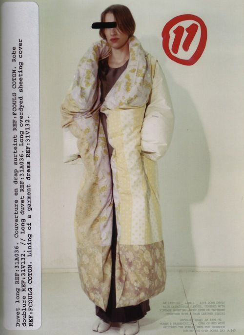 Maison Martin Margiela AW 1999-00_LINE 1_  100% down duvet with detachable sleeves, covered with vintage sheeting, worn open or fastened together with a thin leather string.