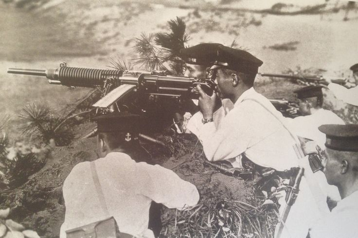 Known as the Special Naval Landing Force, a small contingent of Japanese marines were present on Guadalcanal during the right for the island in late 1942 through early 1943. Well trained and with a strong sense of élan, the SNLF was one of Japan's more capable military formations during World War II. This group, immaculately dressed in their white uniforms and seemingly well positioned are probably either training, or posing for a picture away from the fighting.