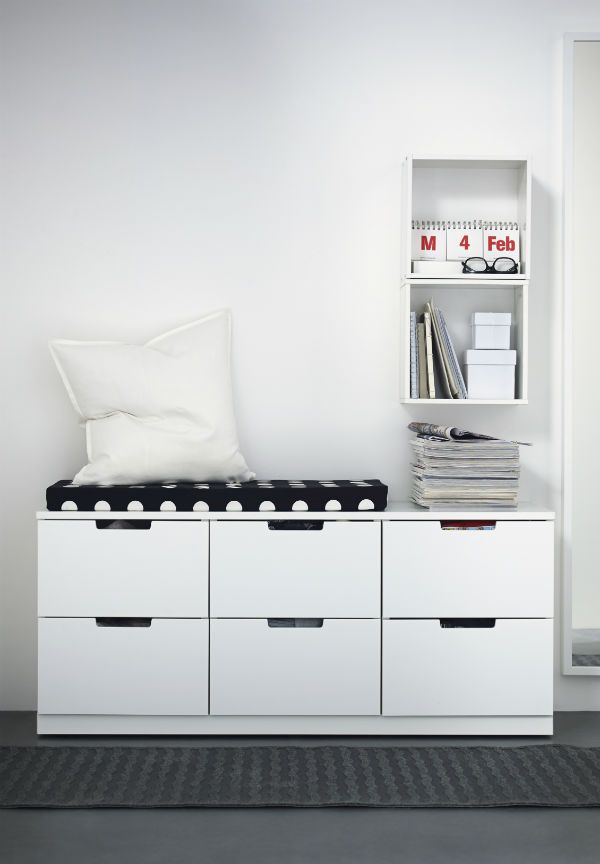 Lots of things in a small space quickly add up to make clutter. A low chest of drawers should give you plenty of storage space to clear it away and it can double as a bench. Open shelving gives you a place to put the things you need to see and of course a mirror for those last minute hair and wardrobe checks.